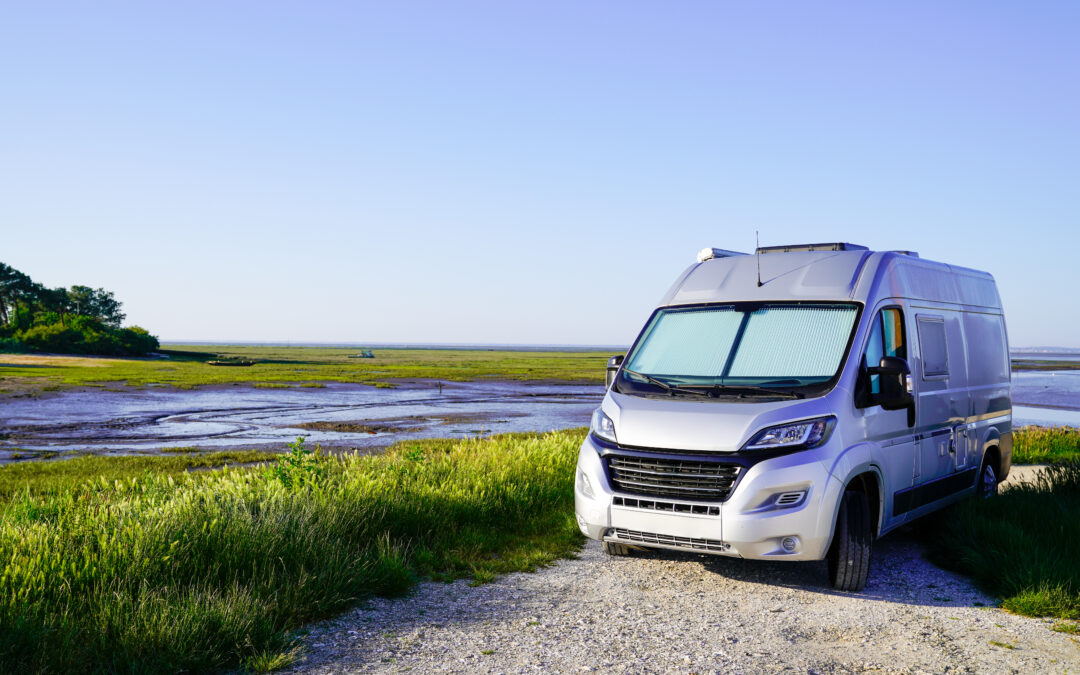 one of the best class b motorhomes parked in the wilderness near a pond