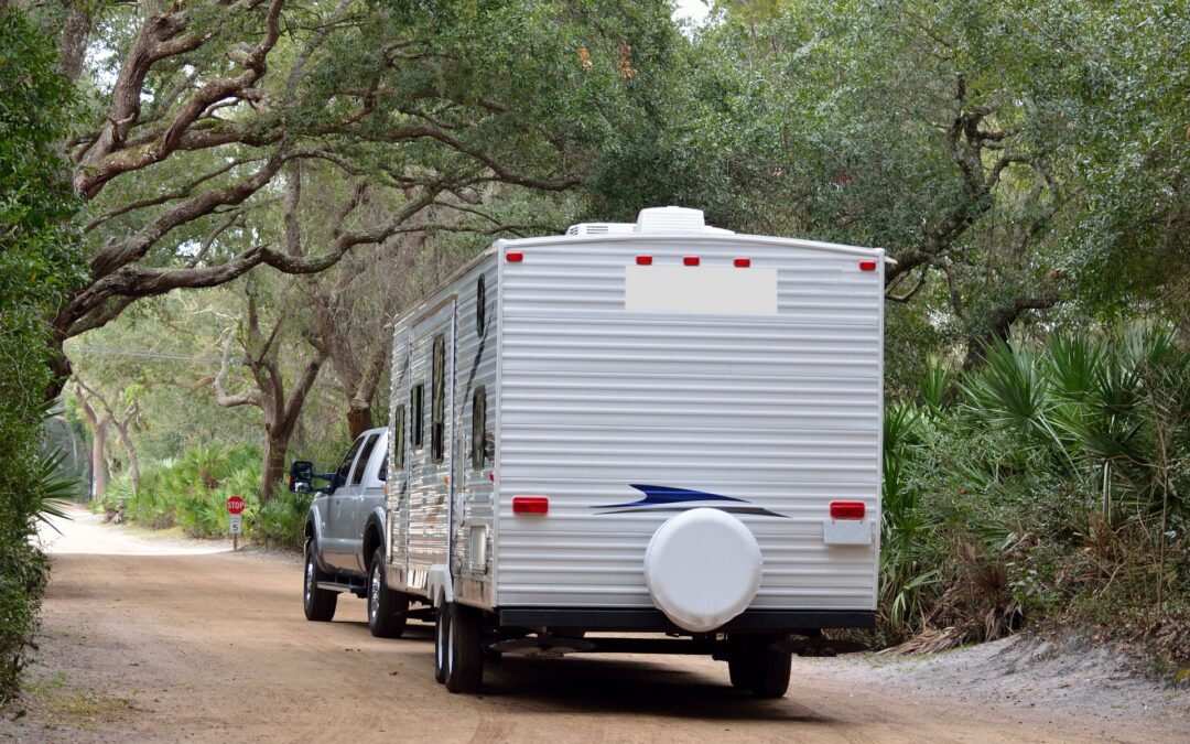 view from behind a travel trailer being pulled by a truck showing waht is the best travel trailer brand